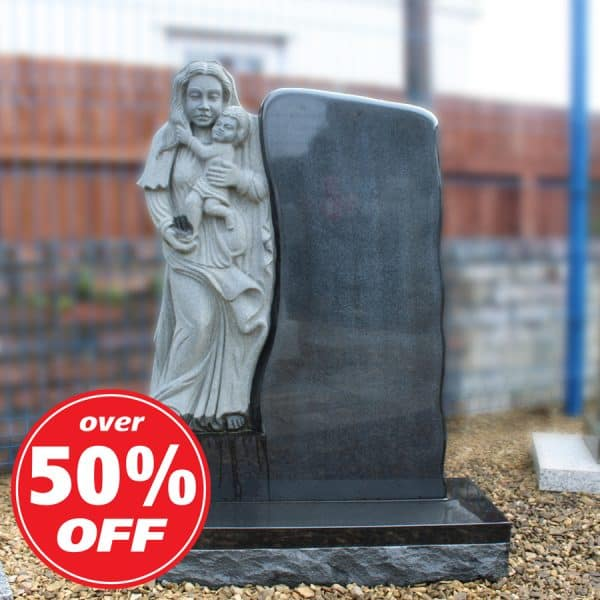 Grey headstone with carved Mary and Jesus design