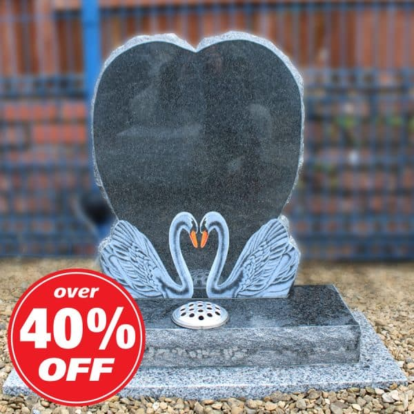 Black heart headstone with engraved swan design