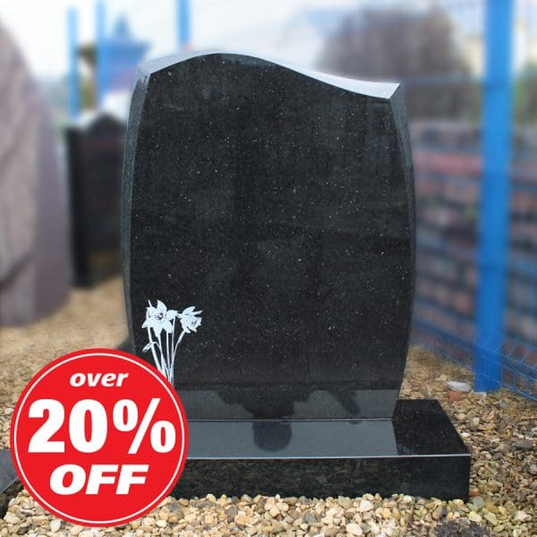 Black granite headstone with engraved daffodil design