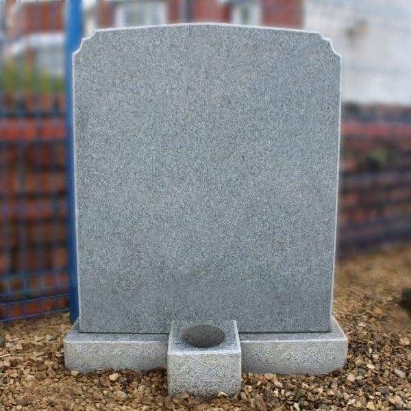 Grey classic headstone with single flower container by CJ Ball & Son