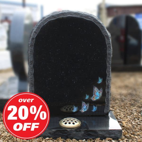 Black rounded headstone with engraved butterfly design