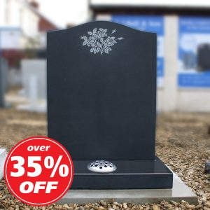 Black ogee headstone with engraved flower design