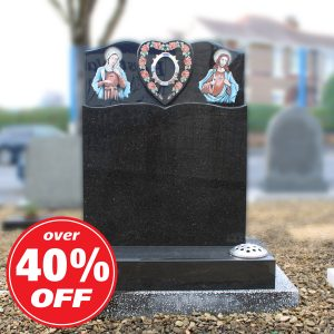 Black headstone with engraved heart and painted Biblical figures