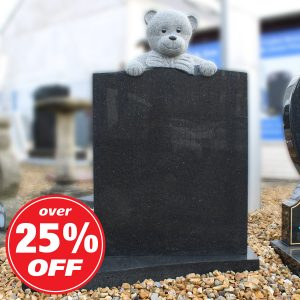 Black children's memorial with engraved bear design