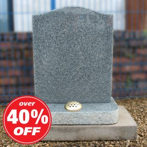 Grey ogee headstone with single flower container