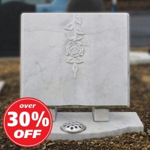 White marble book memorial with engraved rose design