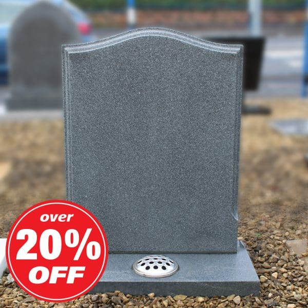 Grey ogee headstone with carved edges