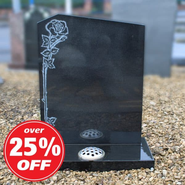Black headstone with engraved rose design
