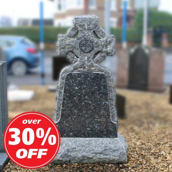 Grey rustic headstone with carved cross design