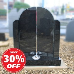 Black 'gates of heaven' headstone with single flower container