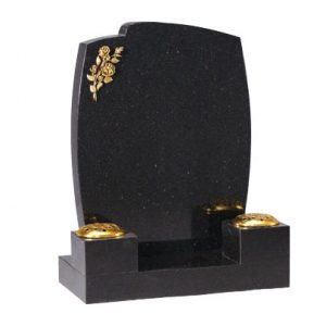 Black headstone with gilded flower design by CJ Ball Memorials
