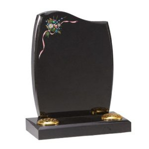 Black headstone with painted flower design
