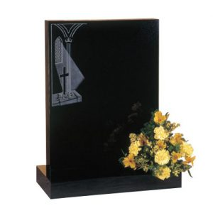 Black rectangular headstone with etched church window scene