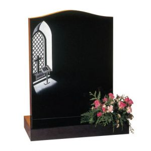 Black ogee headstone with etched church window scene
