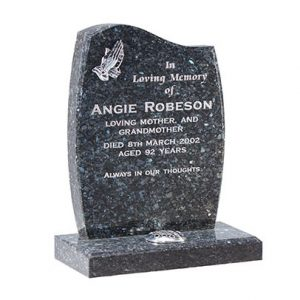 Grey headstone with etched praying hands design and flower container