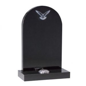 Black rounded headstone with etched bird design