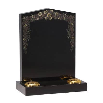 Black pointed headstone with painted flower design