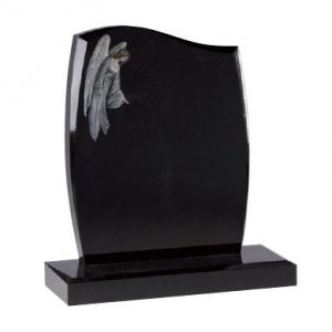 Black headstone with etched angel design
