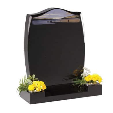 Black ogee headstone with beach scene design by CJ Ball
