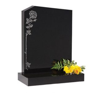 Black headstone with etched rose design and single flower holder