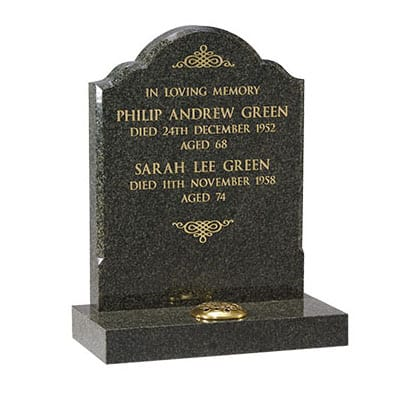 Black rounded headstone with single flower container