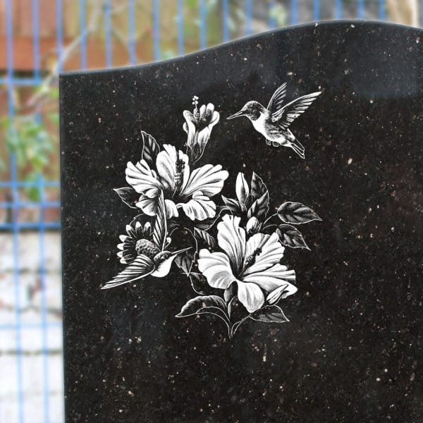 Headstone etching of flowers and bird