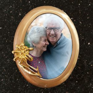 Round bronze memorial photo plaque