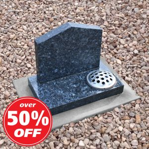 Grey granite pointed headstone with single flower container