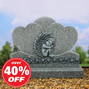 Grey heart headstone with carved cherub design