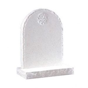 White rounded headstone with rustic edges