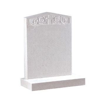 White marble pointed headstone with engraved flower and cross design