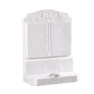White marble cremation memorial with engraved book design