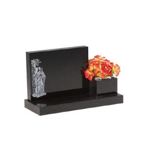 Black cremation memorial with engraved Biblical design and flower holder