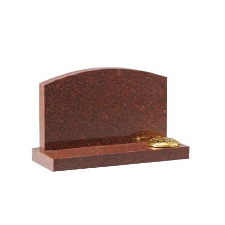 Red granite headstone with flower holder
