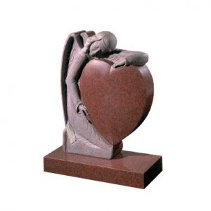 Ruby Red granite with hand carved angel holding a heart