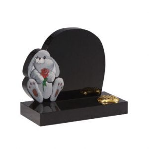 Black granite children's headstone with 'rabbit and rose' ornament