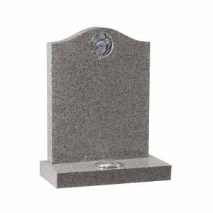 Grey granite ogee headstone with carved and highlighted dove