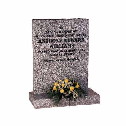 Mervyn Grey granite headstone with pitched edges with painted inscription