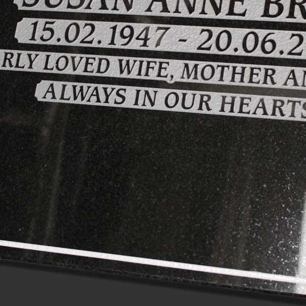 Space left on a black granite cremation memorial